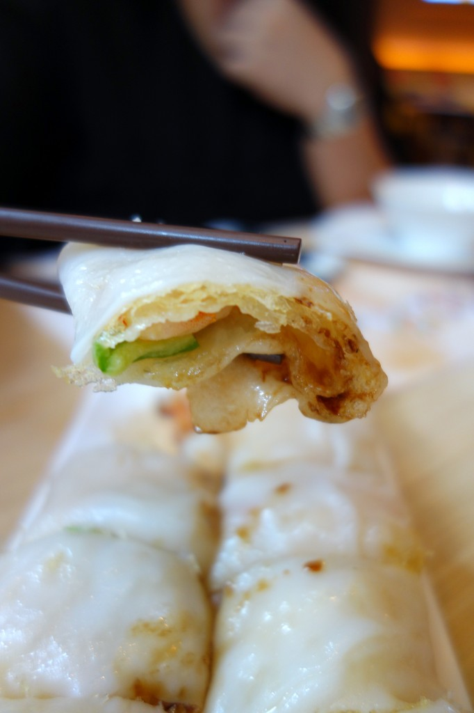 Steamed cheong fun rolled with crispy rice nest and seafood